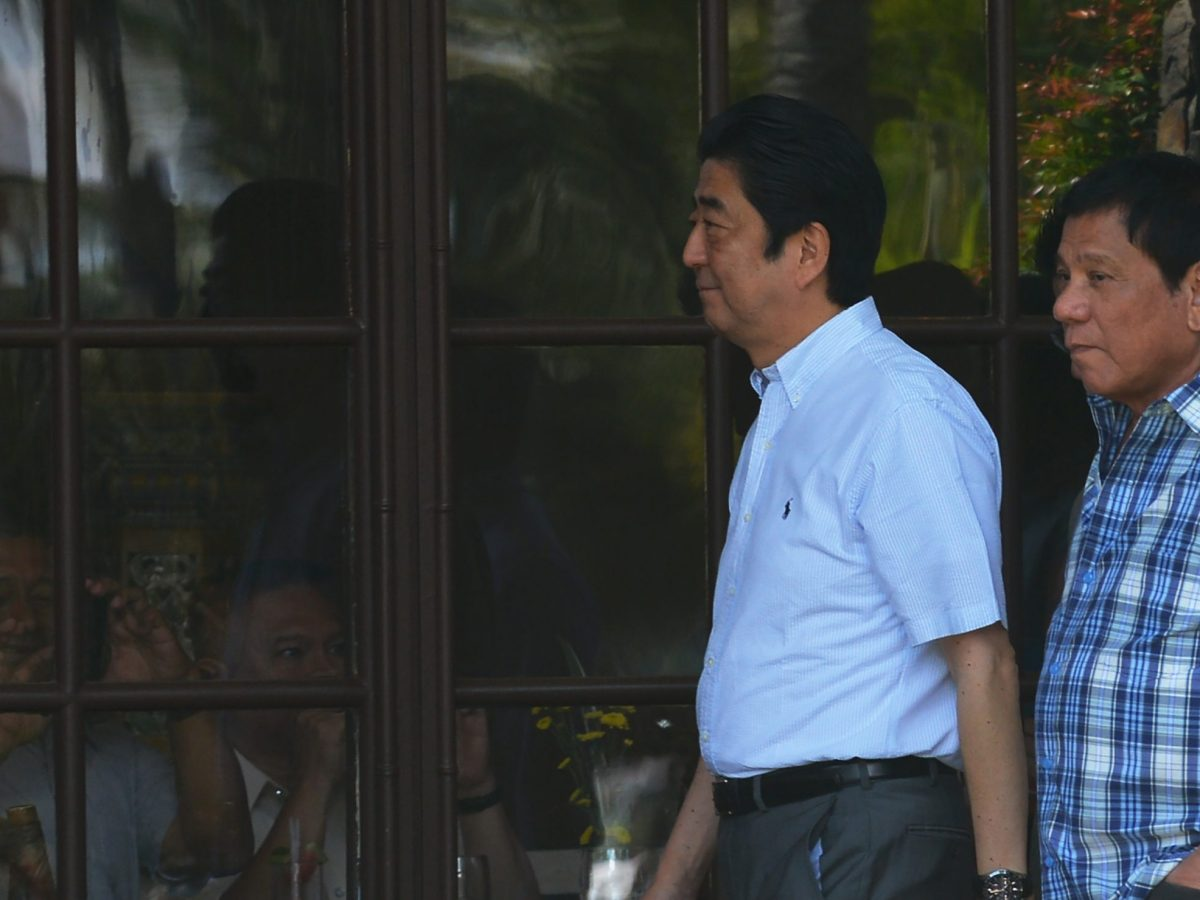 Japanese Prime Minister Shinzo Abe (left) walks with Philippine President Rodrigo Duterte (right)  in Davao City on January 13, 2017. Photo: AFP / Ted Aljibe