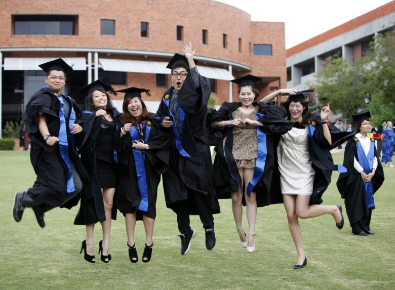 Chinese students pose during a graduation photo shoot at Curtin University in Bentley, Perth, Western Australia. Photo: AFP