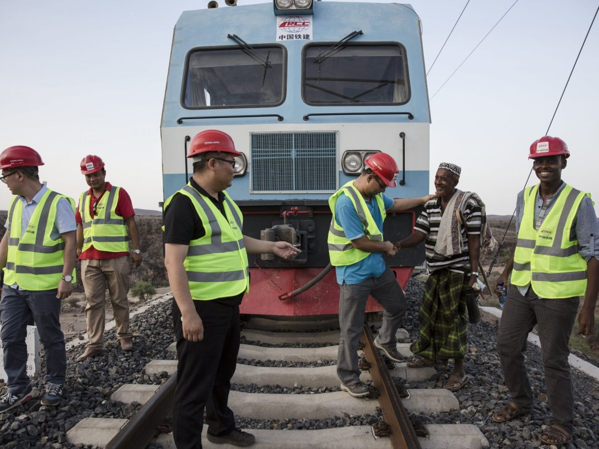 A local resident greets Chinese and African workers on the Addis Ababa–Djibouti railway.  Photo: Qin bin / Imaginechina