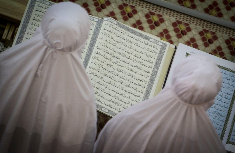 MALAYSIA, Kuala Lumpur: Malaysian Muslims attend prayers on the eve of the first day of the Islamic fasting month of Ramadan at National Mosque in Kuala Lumpur on June 5, 2016. In Muslim nations and regions around the globe, this is the first week of the holy month of Ramadan, a time for followers to abstain from eating, drinking, smoking and sexual activity during the day, breaking their fast each sunset, with traditional meals and sweets.  - Aiman Arshad