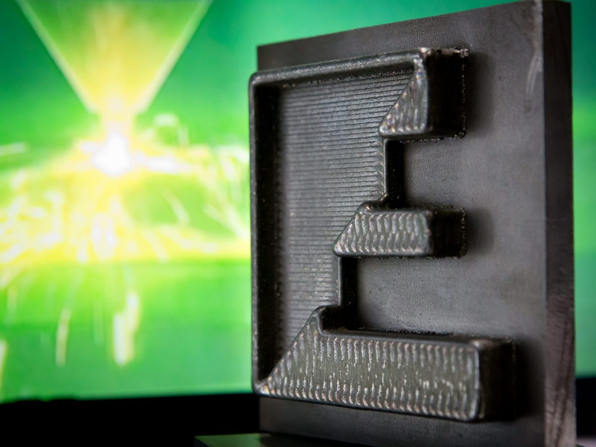 San Diego-based Formalloy shows a 3D-printed metal piece, made in roughly 90 minutes, at the Frontier Tech Forum in December 2016. Photo: DPA