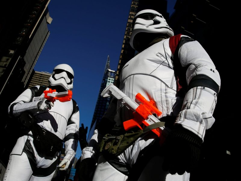 People dressed as Stormtroopers from Star Wars Rogue One walk in Times Square on Christmas Day in Manhattan, New York City, U.S., December 25, 2016. REUTERS/Andrew Kelly