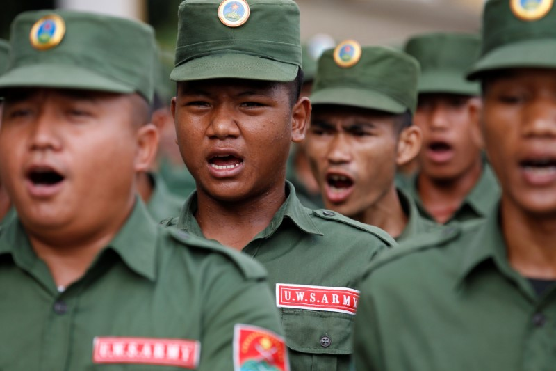 In tune: United Wa State Army soldiers during a media display in Panghsang, Wa territory in northeast Myanmar October 4, 2016. Photo: Reuters/Soe Zeya Tun