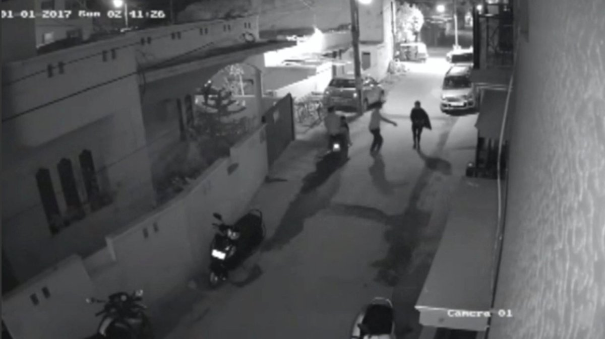 Two men on a scooter assault a woman, attempting to take off her clothes and pushing her to the ground before leaving, in Bangalore, India, in this still image taken from January 1, 2017, CCTV footage. Photo: Local resident CCTV footage/via Reuters TV