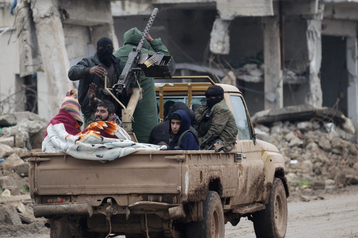 Rebel fighters ride on a pick-up truck in the northern Syrian rebel-held town of al-Rai, Syria January 5, 2017. REUTERS/Khalil Ashawi