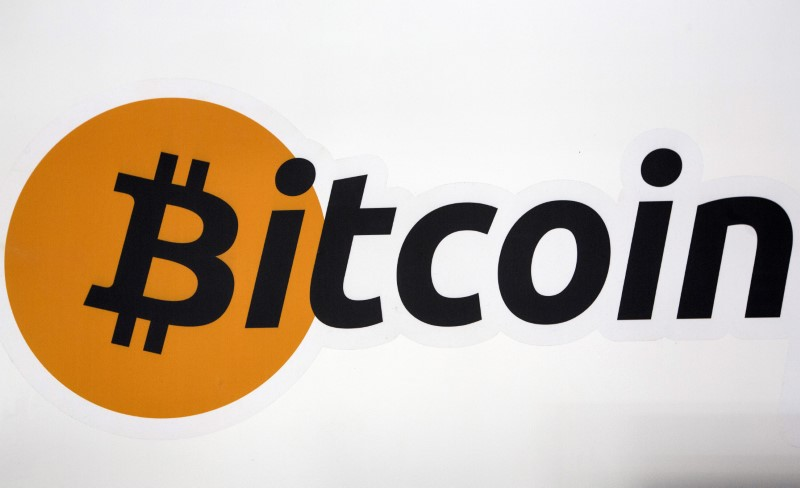 A Bitcoin logo at the Bitcoin Center in New York's financial district on July 28, 2015. Photo: Reuters/Brendan McDermid