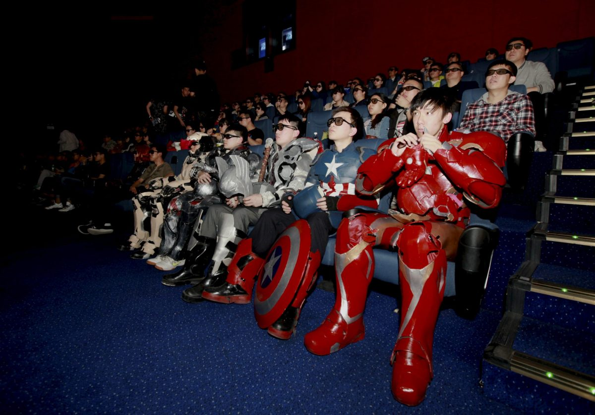 "FILE PHOTO - A group of fans dressed in homemade replica armour of ""Avengers: Age of Ultron"" movie characters, Iron Man, Captain America and Thor, watch the film in a theatre in Changchun, Jilin province, China on May 16, 2015.   REUTERS/Stringer   ATTENTION EDITORS - CHINA OUT. NO COMMERCIAL OR EDITORIAL SALES IN CHINA"