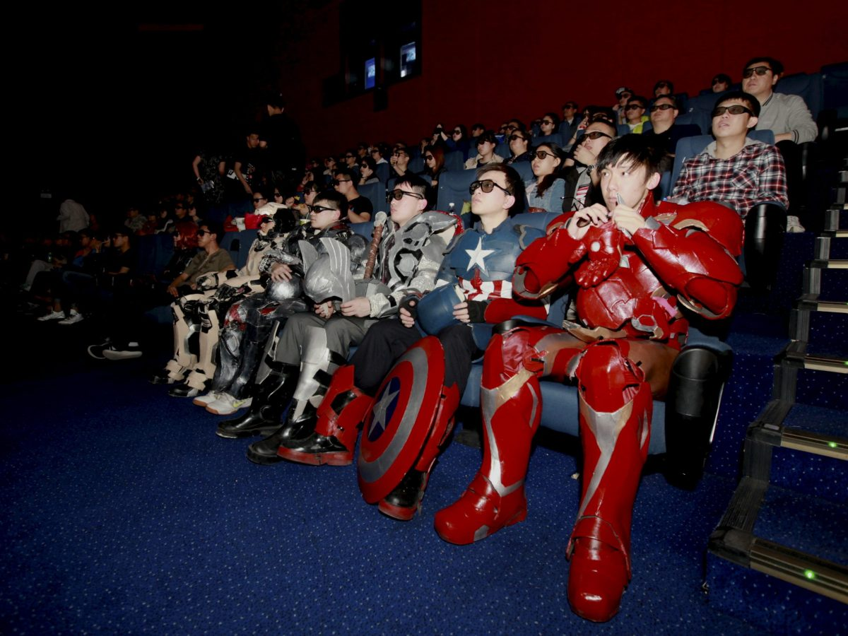 """FILE PHOTO - A group of fans dressed in homemade replica armour of """"Avengers: Age of Ultron"""" movie characters, Iron Man, Captain America and Thor, watch the film in a theatre in Changchun, Jilin province, China on May 16, 2015.   REUTERS/Stringer   ATTENTION EDITORS - CHINA OUT. NO COMMERCIAL OR EDITORIAL SALES IN CHINA"""