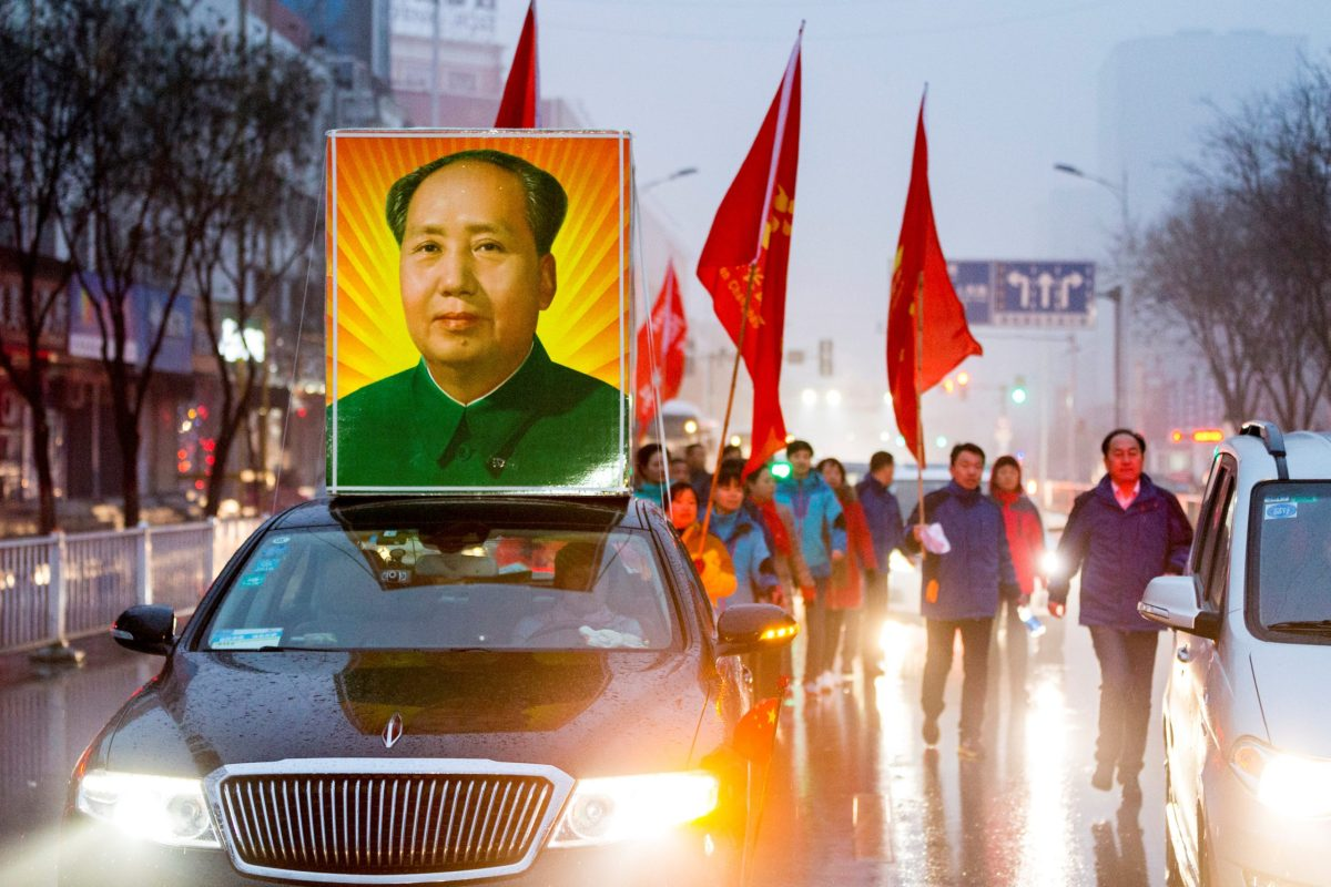 A picture of China's late Chairman Mao Zedong as people gather to celebrate his 123rd birth anniversary in Shaoshan, Hunan province, December 26, 2016. Reuters/Stringer