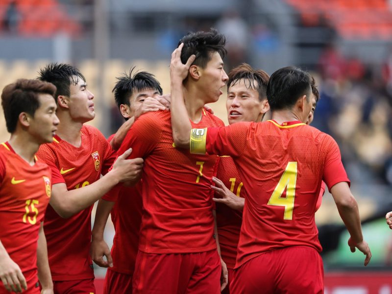 Wang Jingbin of China celebrates with teammates after he scored against Croatia in the Gree China Cup in Nanning. Photo: Reuters/Stringer