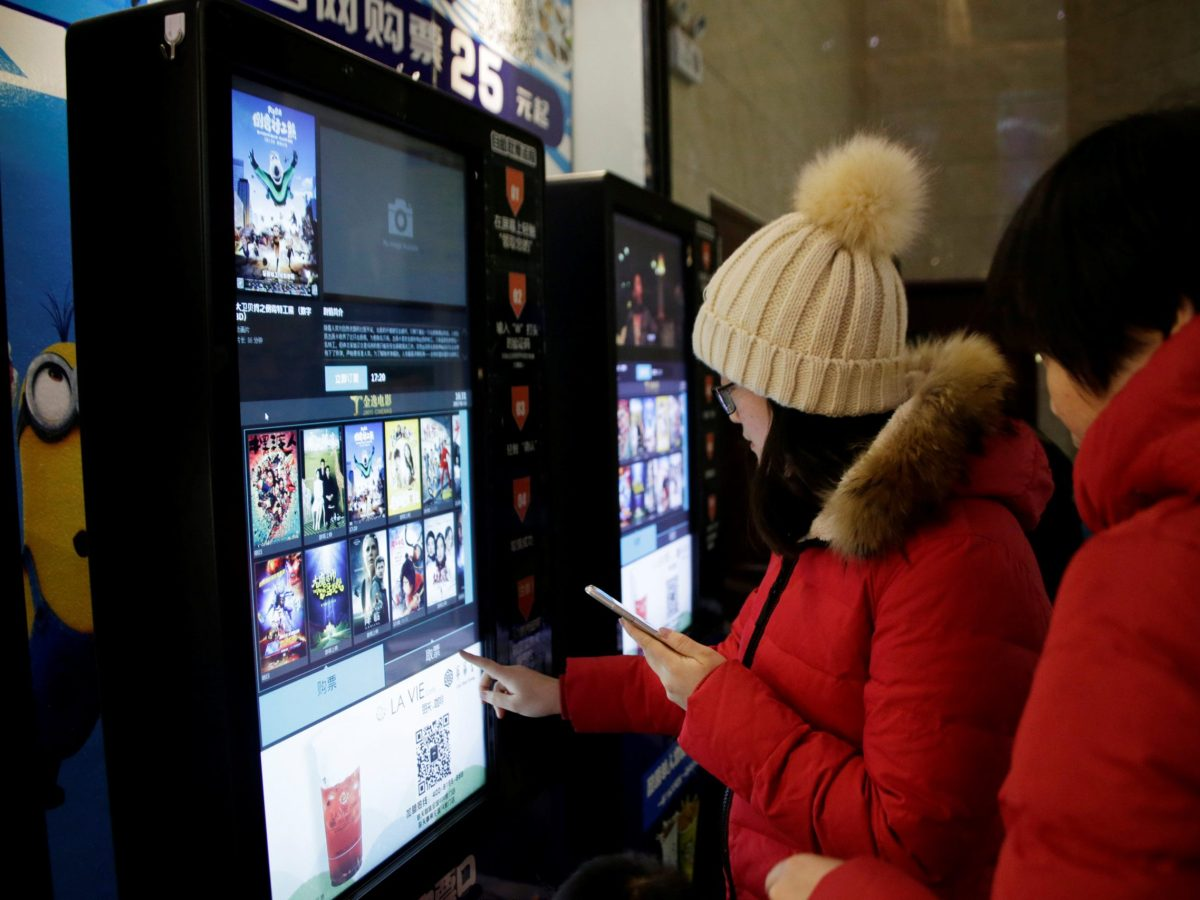 People print movie tickets from a machine at a cinema in Tianjin, China, January 13, 2017. Photo: Reuters/Jason Lee
