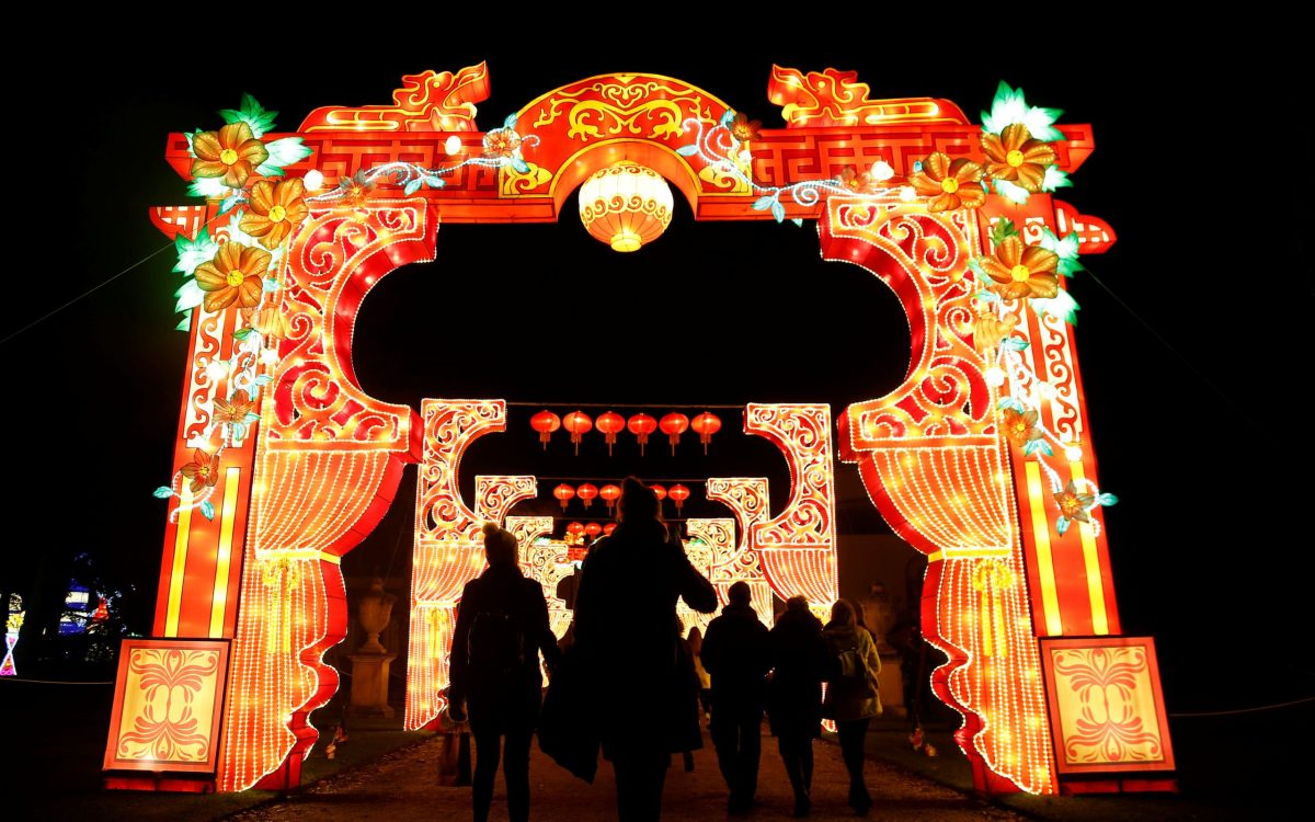 People are silhouetted against a light display during the The Magical Lantern Festival marking the Chinese new year at Chiswick House in London, Britain January 18, 2017. REUTERS/Neil Hall