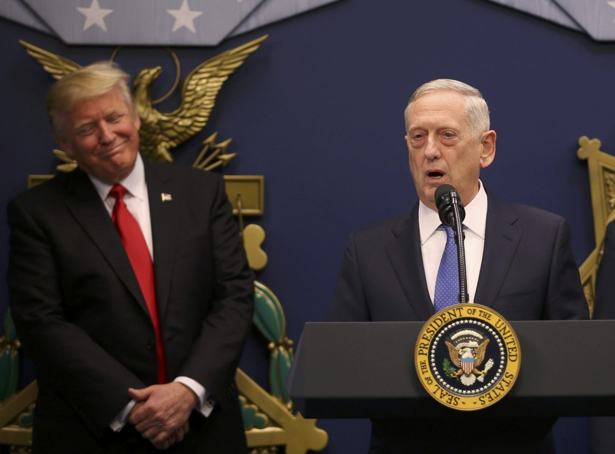 U.S. President Donald Trump listens to  remarks by Defense Secretary James Mattis (R) after a swearing-in ceremony for Mattis  at the Pentagon in Washington, U.S., January 27, 2017. Reuters/Carlos Barria