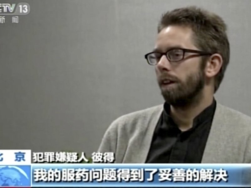 Screen shot of Peter Dahlin speaking with the state China Central Television. Photo via The Guardian.