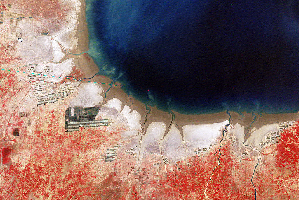 Salt flats in the Bohai Sea in China's northeast as seen from Space. Photo: Nasa, via Wikimedia Commons
