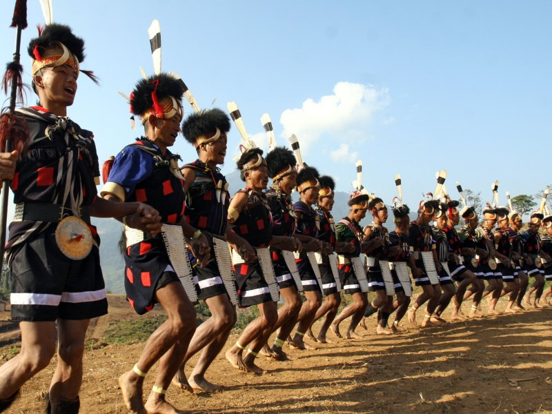 Naga tribesmen clad in traditional outfits are seen during New Year celebrations in Laha of Khamti Township in northwestern Myanmar bordering India's Assam state. The Naga are among the most isolated people in the world. Photo: AFP / Khin Maung Win