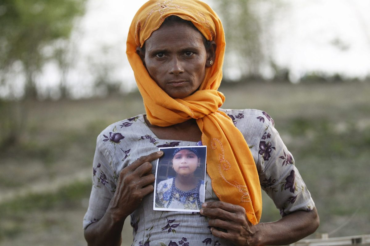 Rohiakar, a Rohingya Muslim woman, shows a picture of her daughter Saywar Nuyar, 22, who was being held by a human trafficker in 2015. Photo: Reuters.