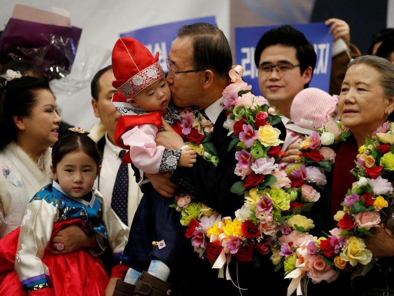 Former UN chief Ban Ki-moon kisses a boy as he arrives at Incheon International Airport.  Photo: Reuters/Kim Hong-ji