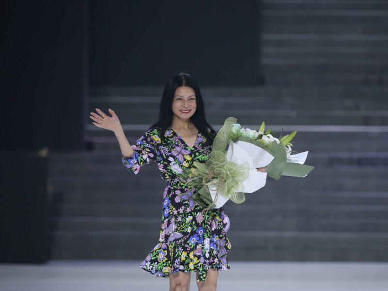 New York-based designer Vivienne Tam takes applause after her show. Photo: Courtesy of Vivienne Tam