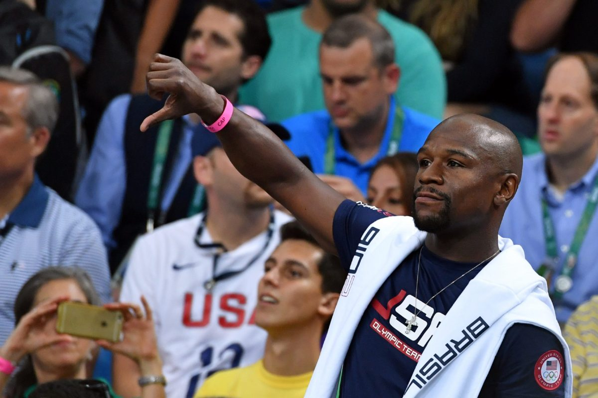 Floyd Mayweather reacts while watching a Men's quarterfinal basketball match between the US and Argentina in Rio de Janeiro during the 2016 Olympic Games. Photo: AFP