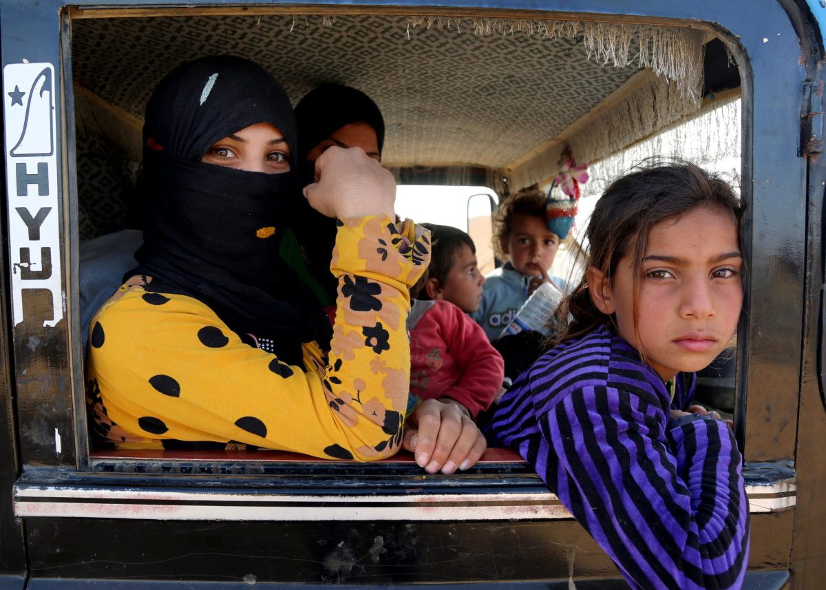 A Syrian family is carried to safety from areas controlled by Islamic State jihadists near Raqqa in Syria on November 9, 2016. Photo: AFP/Delil Souleiman
