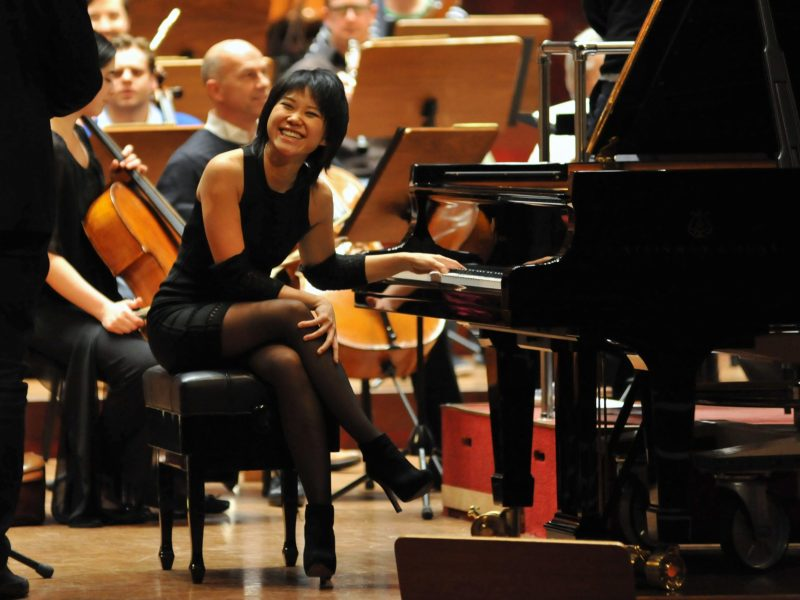 Chinese pianist Wang Yuja smiles during a rehearsal at the National Concert Hall in Taipei  in 2014.  AFP PHOTO / Mandy CHENG / AFP PHOTO / Mandy Cheng