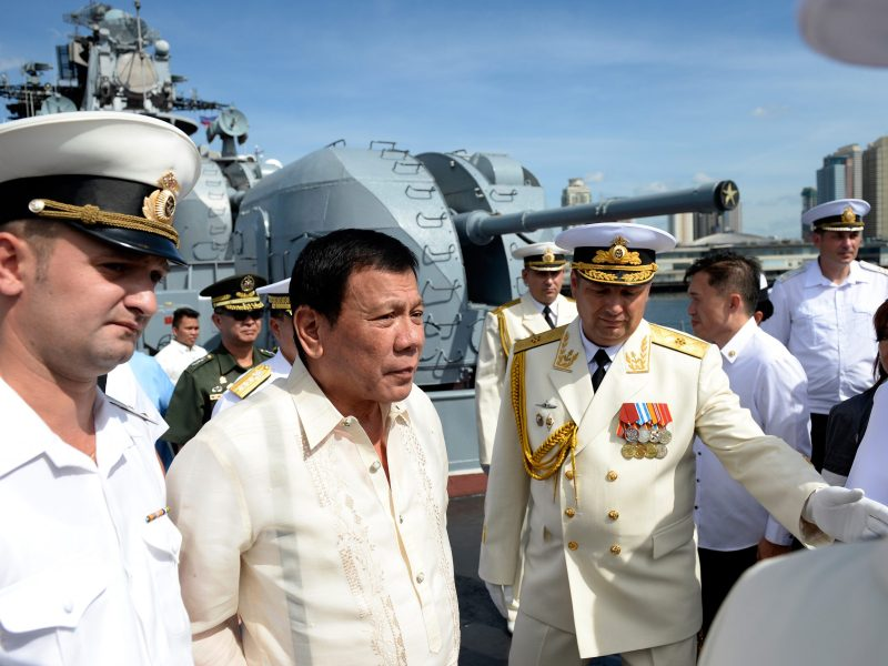 Russia's Rear Admiral Eduard Mikhailov (R) leads the way as he guides Philippines' President Rodrigo Duterte (2nd L) onboard the Russian anti-submarine navy ship Admiral Tributs in Manila on January 6, 2017. Photo: AFP / Noel Celis