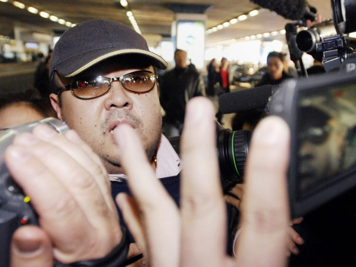 This photo taken on February 11, 2007 shows a man believed to be then-North Korean leader Kim Jong-il's eldest son, Kim Jong-nam, walking among journalists upon his arrival at Beijing's international airport.Photo: Jiji Press via AFP