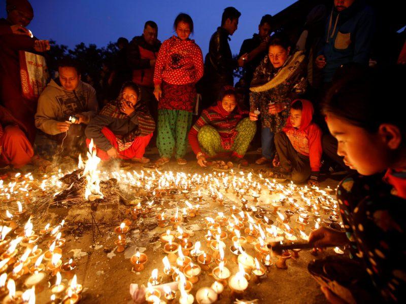 Smart prayers. Devotees offer butter lamp to celebrate the Shreepanchami festival at Saraswati temple. Photo: Reuters/Navesh Chitrakar