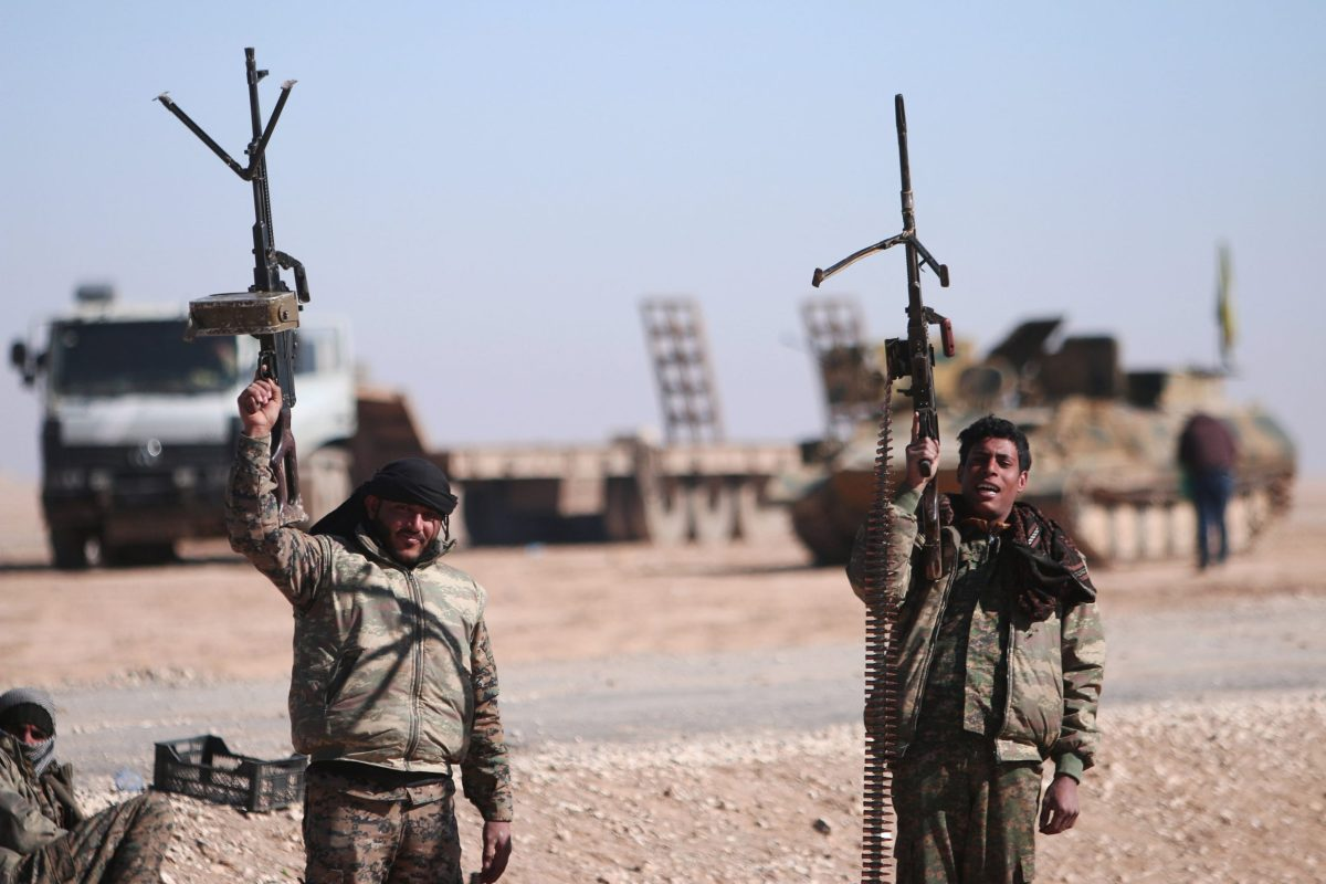 Syrian Democratic Forces (SDF) fighters hold up their weapons in the north of Raqqa city, Syria February 3, 2017. Photo: Reuters/Rodi Said