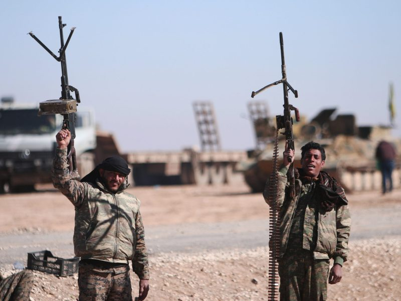 Syrian Democratic Forces (SDF) fighters hold up their weapons in the north of Raqqa city, Syria February 3, 2017. REUTERS/Rodi Said