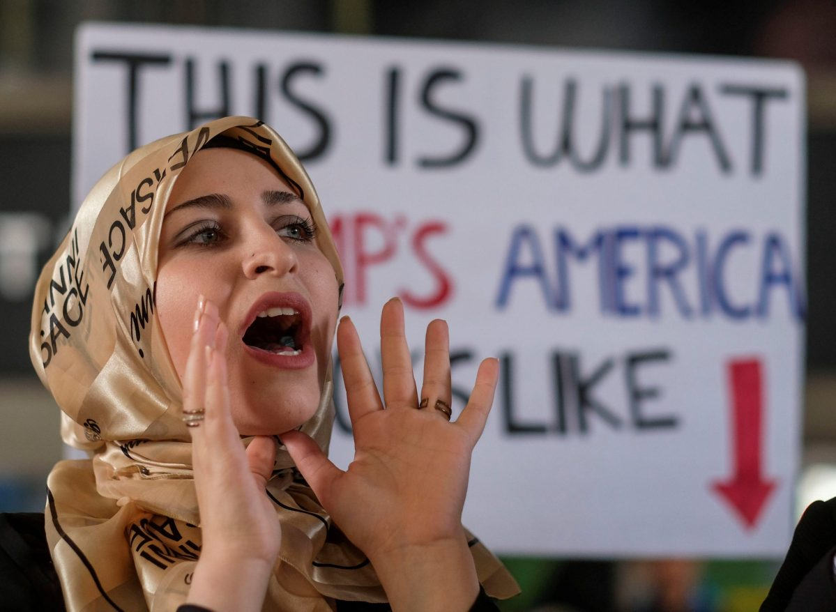 A demonstrator against the immigration rules implemented by US President Donald Trump's administration, protests at Los Angeles international airport. Photo: Reuters/Ringo Chiu