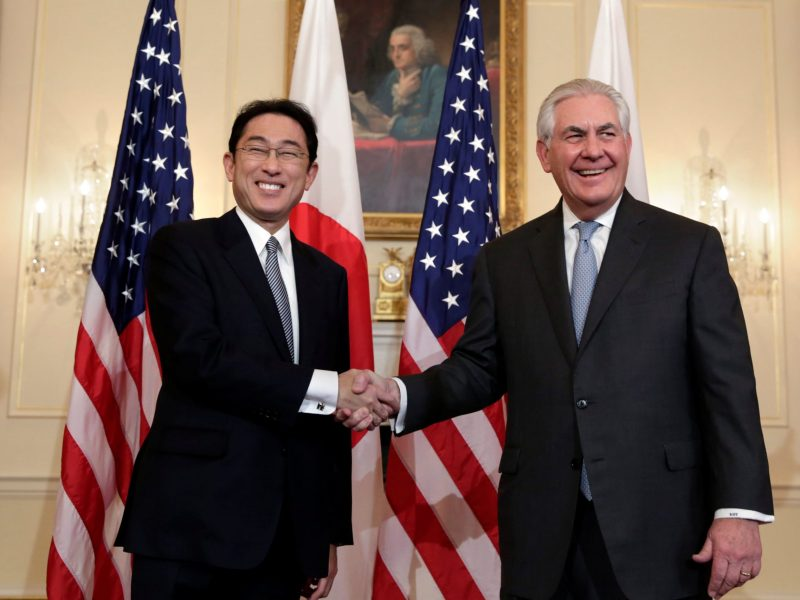 U.S. Secretary of State Rex Tillerson (R) shakes hands with Japanese Foreign Minister Fumio Kishida before their meeting at the State Department in Washington D.C., U.S. February 10, 2017. REUTERS/Yuri Gripas     TPX IMAGES OF THE DAY
