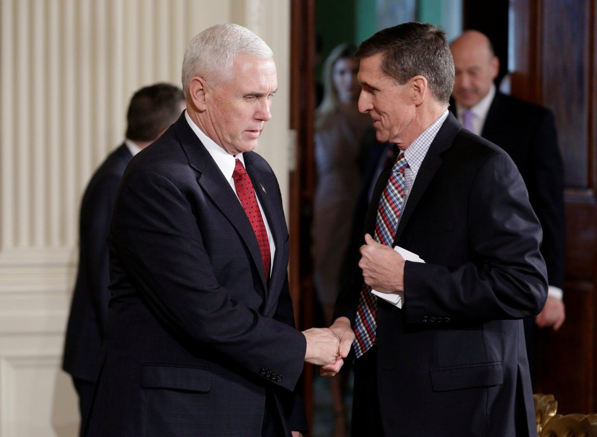 US Vice President Mike Pence (left) greets the short-lived National Security Advisor Michael Flynn at the White House on February 10, 2017.     Photo: Reuters / Joshua Roberts