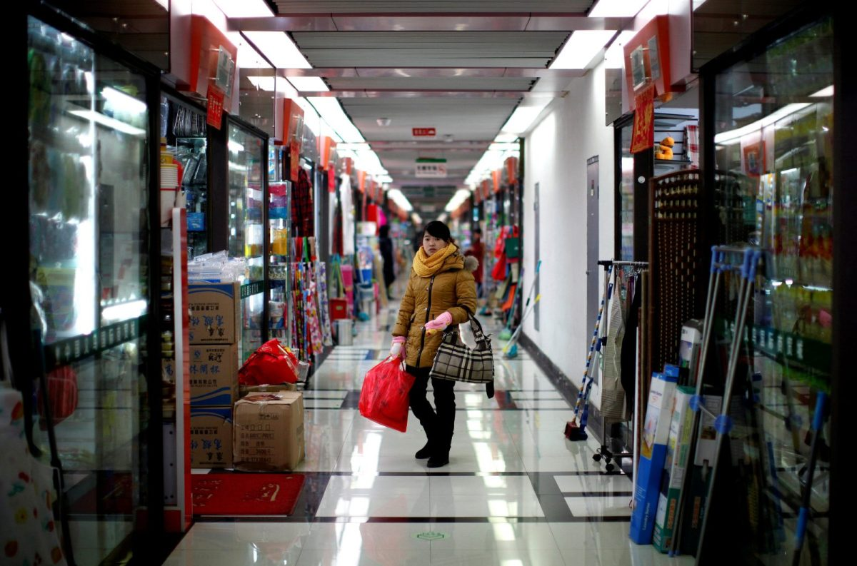 A woman pauses as she shops at a wholesale market in Yiwu, Zhejiang province January 11, 2011.   Photo: Reuters /Carlos Barria