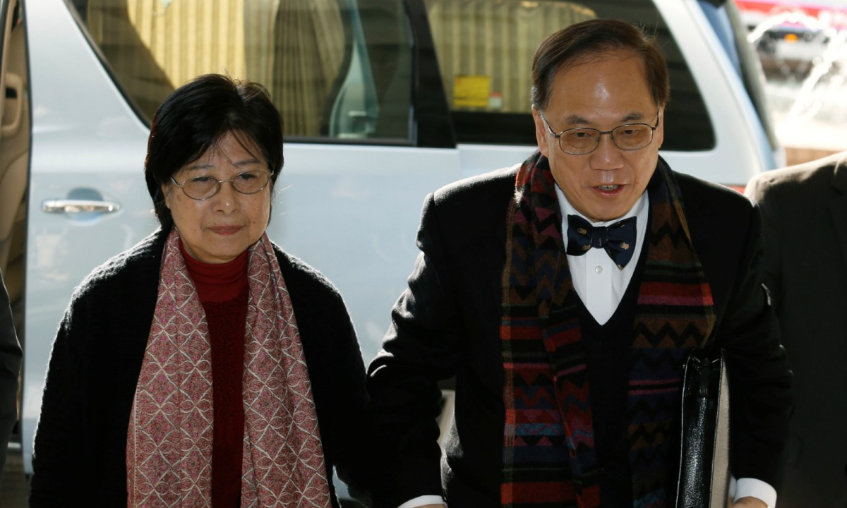 Former Hong Kong Chief Executive Donald Tsang (right) and his wife Selina arrive at the High Court during his trial on charges of misconduct in Hong Kong February 15, 2017. Photo: Reuters/Bobby Yip