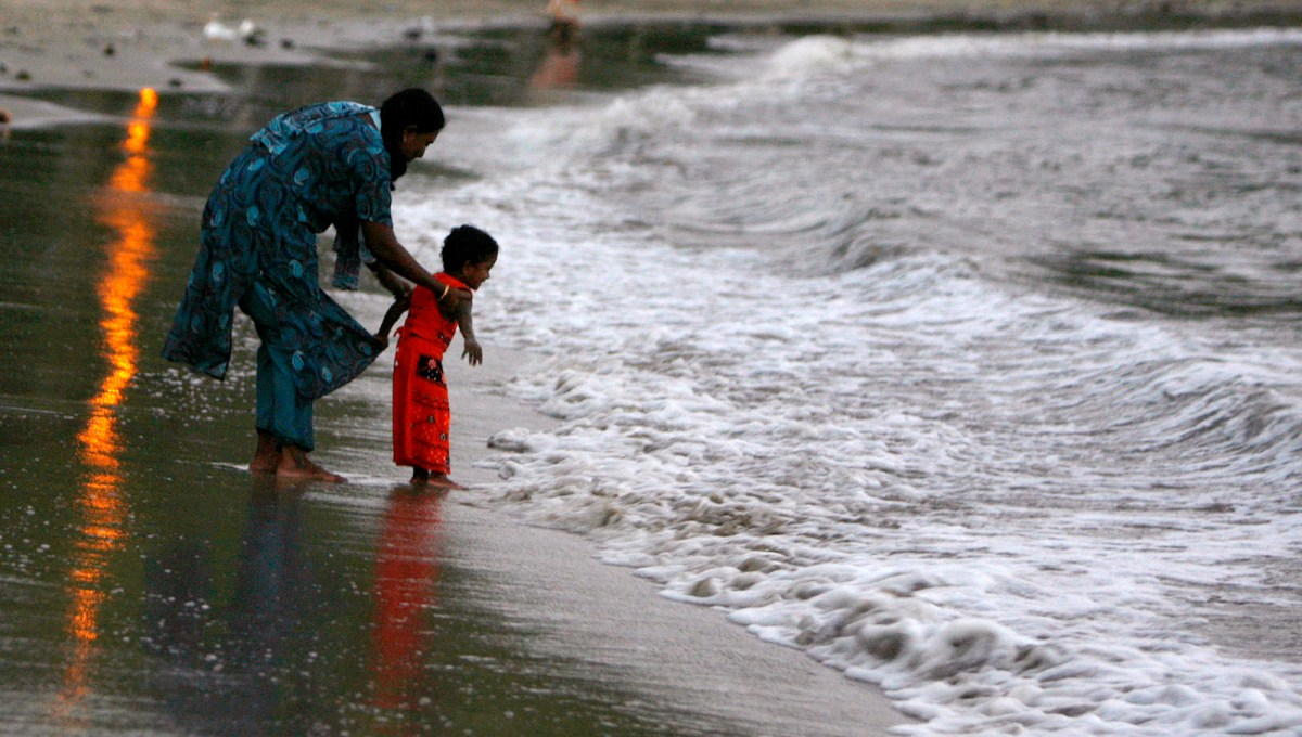 A child plays with his mother at a beach in Port Blair, capital of India's Andaman and Nicobar islands. Tribal populations are endangered in the archipelago. Photo: Adnan Abidi, Reuters