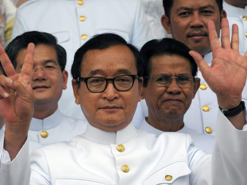 Cambodian opposition leader Sam Rainsy stepped down as president of the Cambodia National Rescue Party on Saturday. The exiled politician and his party members have come under rising political pressure ahead of crucial elections. Photo: AFP / Tang Chhin Sothy