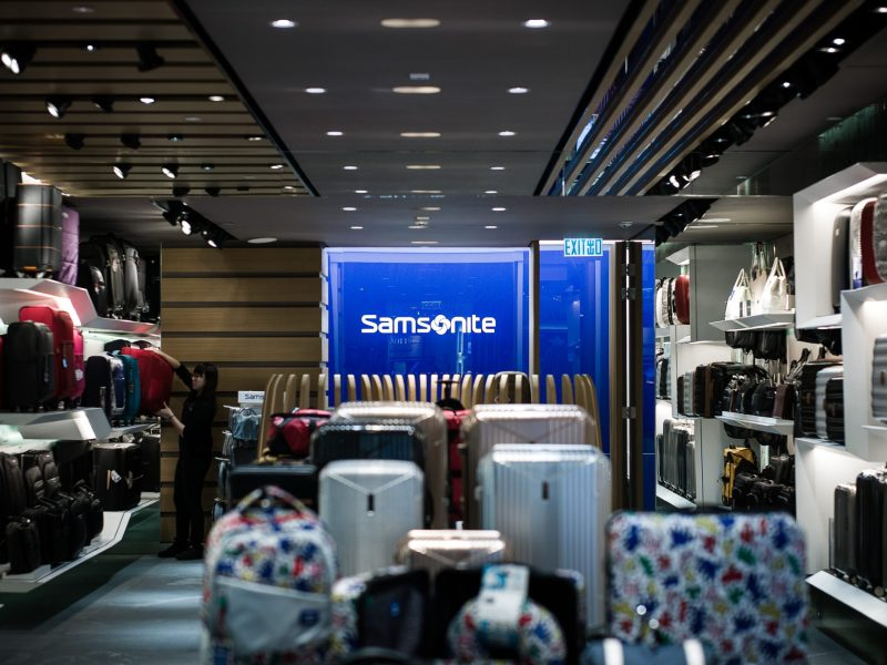 An employee arranges suitcases at a shop for luggage giant Samsonite in Hong Kong. Photo: AFP/Philippe Lopez