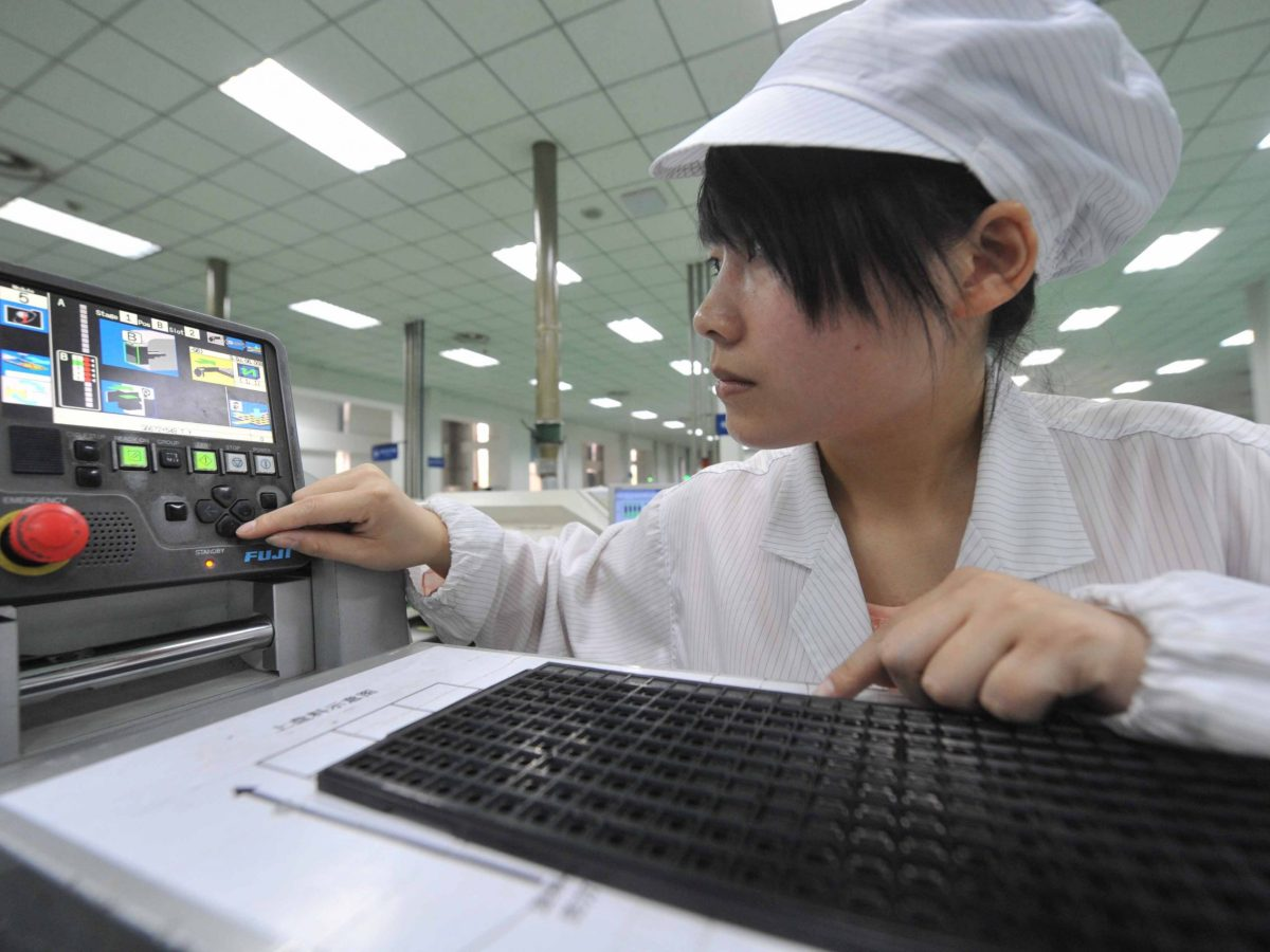 A Chinese worker tests circuit boards at a factory in Sichuan province. Photo: AFP