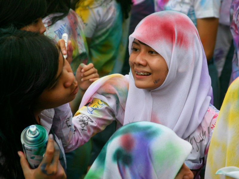 High school students in Sumatra celebrate the end of national exams before heading to university.   Photo: Roni Bintang, Reuters