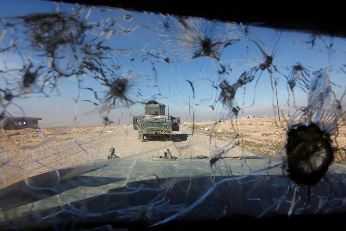 """Iraqi rapid response forces advancing towards the south of Mosul. Donald Trump won the Republican primaries and the general election in part by attacking the Iraq War, which he likened to """"throwing rocks into a hornets' nest."""" Photo: Reuters"""