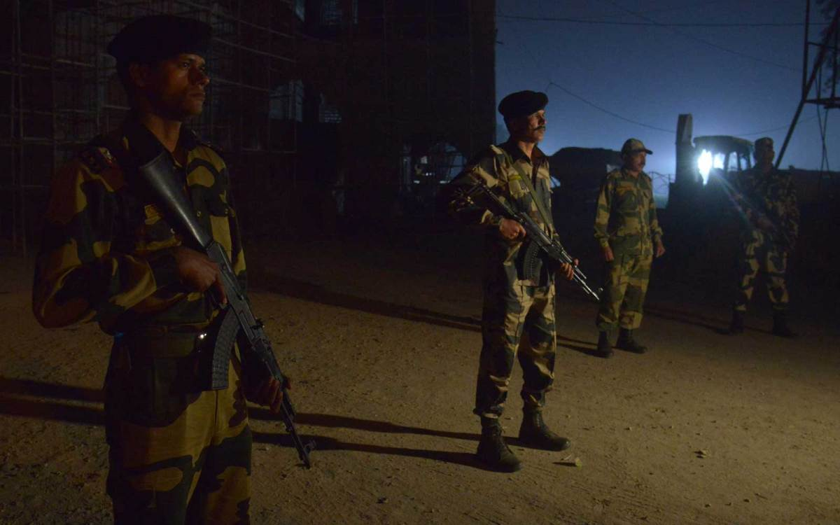 Indian Border Security Force personnel stand guard next to a construction site at the India-Pakistan Wagah border near Amritsar.  Photo: Narinder Nanu, Agence France Presse