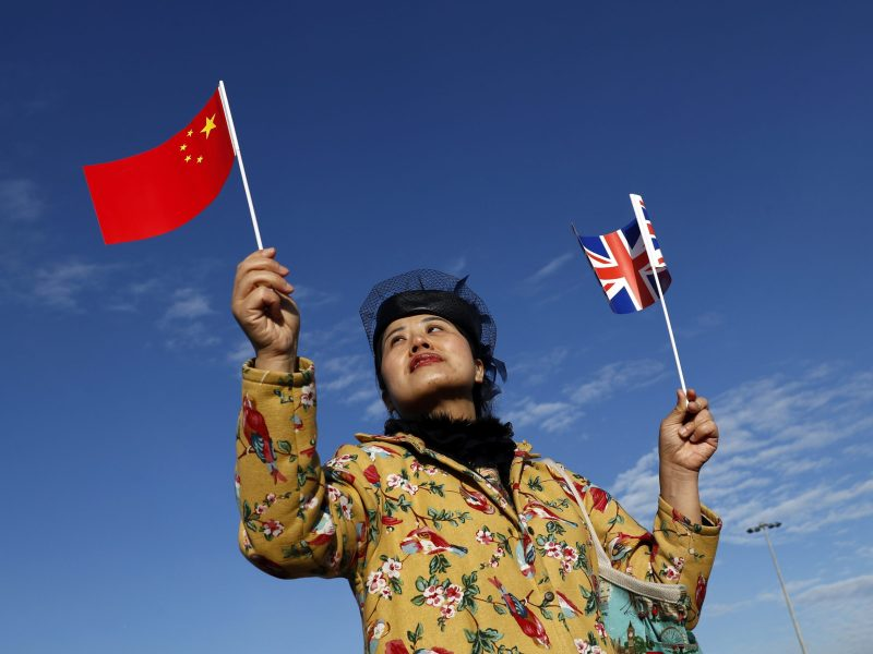 A woman attends a welcoming ceremony to mark the inaugural trip of the first freight train to travel from China to Britain on January 18, 2017. Photo: Reuters / Stefan Wermuth
