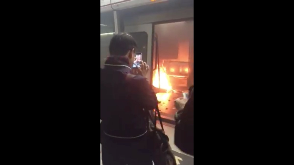 Screen grab of an MTR compartment on fire. Photo: facebook/Cathy Wong