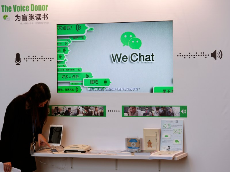 A counter promoting WeChat is displayed in Hong Kong. Photo: Bobby Yip, Reuters