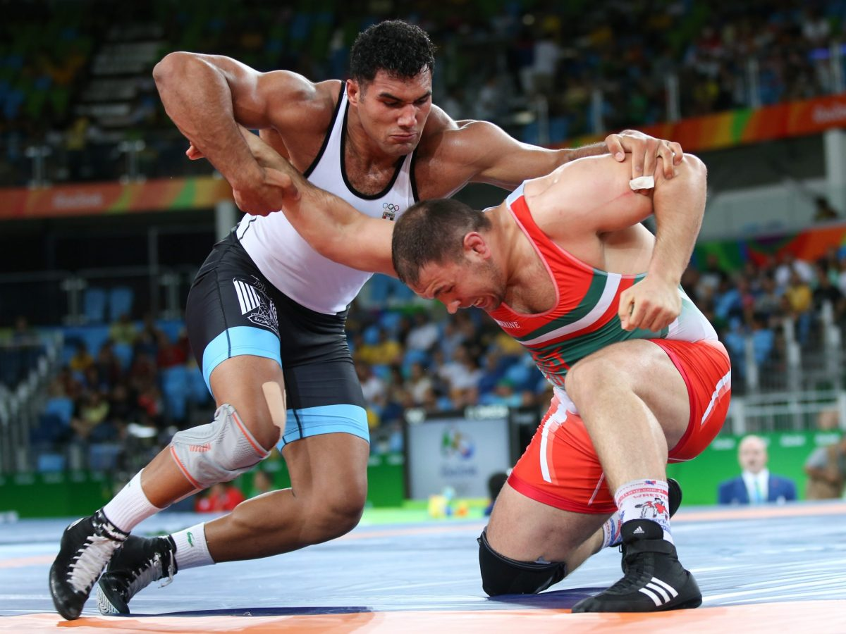 Like their two heavyweight wrestlers seen here battling it out for gold at last year's Olympics, Egypt and Iran have been great rivals for centuries. But they have also proved great sources of stability and repositories of civilization. Photo: Reuters