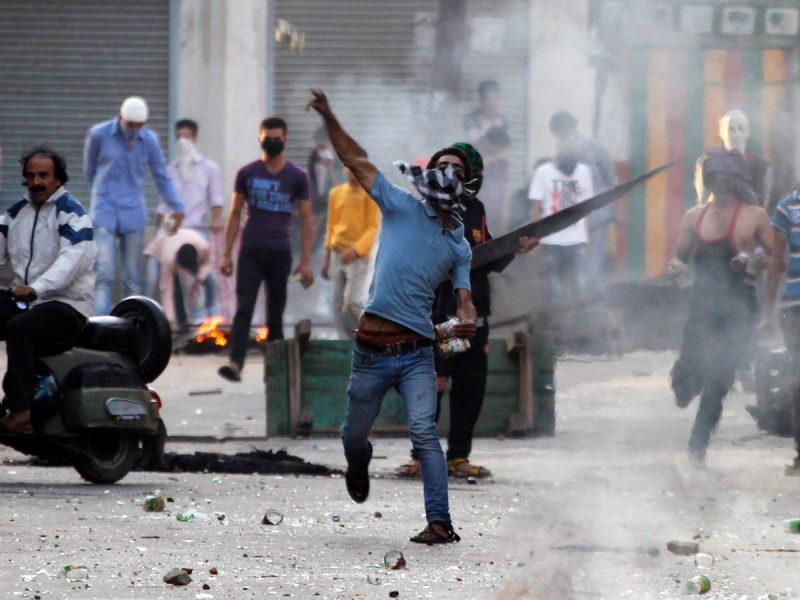File image of a protester throwing a stone at the police during a strike called by separatist groups against killings in southern Kashmir. Photo: Reuters