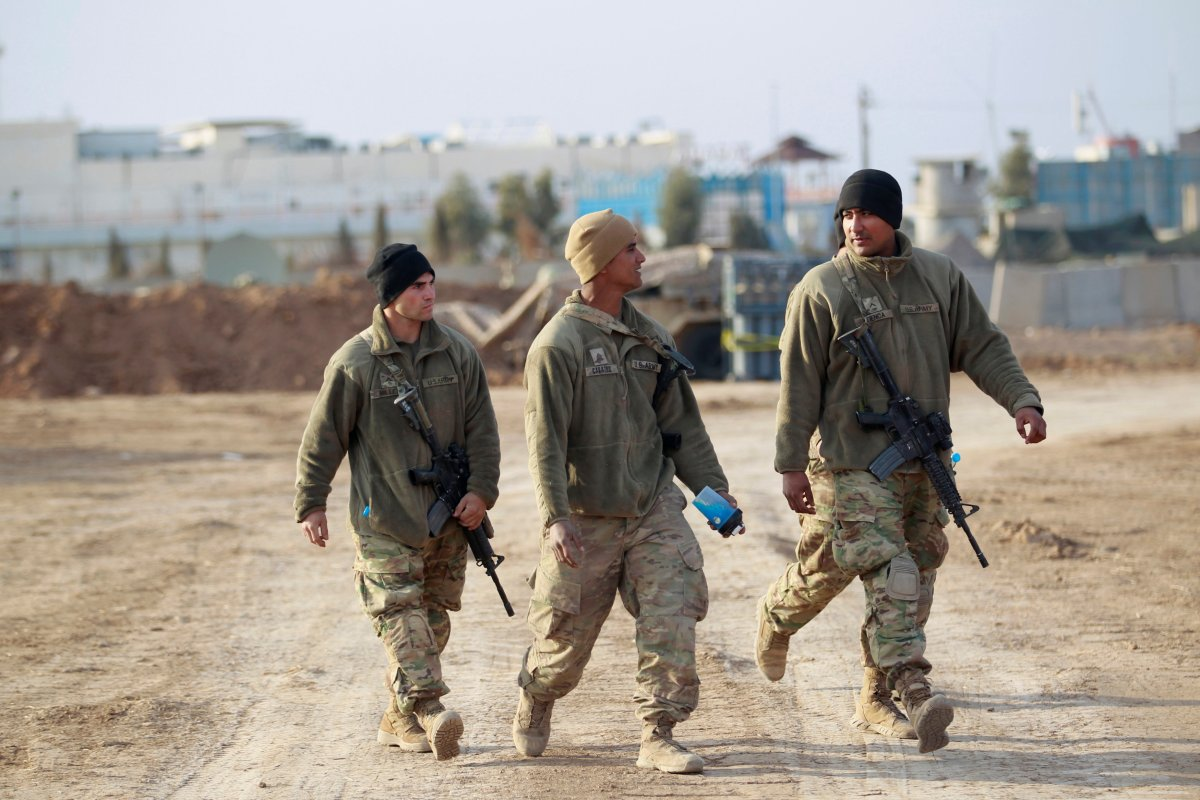 US soldiers from the 2nd Brigade, 82nd Airborne Division walk through a military base north of Mosul on February 14. Photo: Khalid al Mousily, Reuters