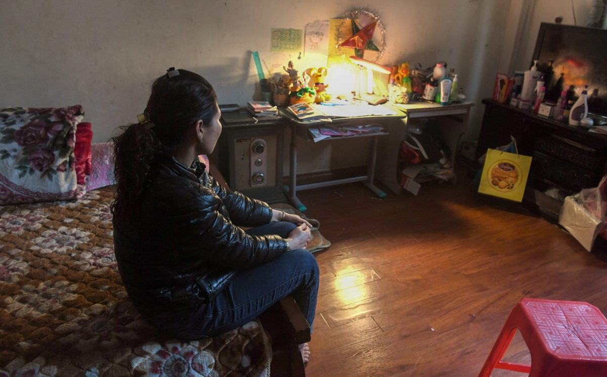 Nga (not her real name),  mother of an abused girl, in her Hanoi home. Nga's eight-year-old daughter still wails in her sleep, haunted by the memory of being molested by a family friend. Photo: AFP